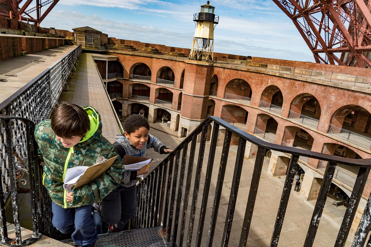 Students walking up the stairs at Fort Point