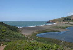 View of the Pacific Ocean, Rodeo Lagoon and barrier beach from the lagoon trail