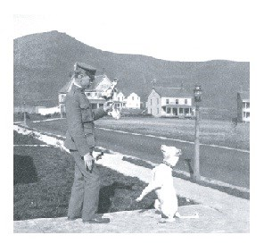 Soldier tempting dog at Fort Baker
