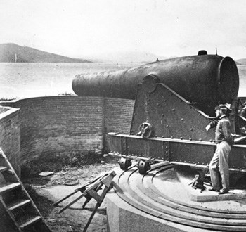 historic photo of Civil War soldier at mounted Fort Alcatraz canon overlooking San Francisco Bay