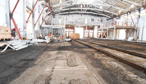 interior of Pier Shed 2 showing historic railroad tracks now unearthed from asphalt