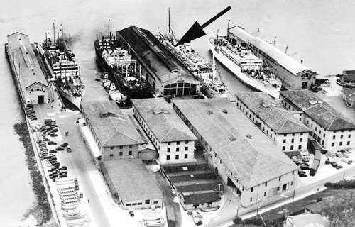 historic aerial of SF Port of Embarkation; large buildings in crowded pier area
