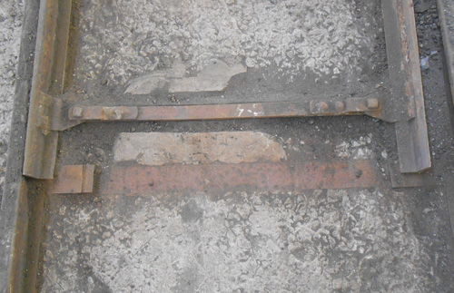 close-up detail of steel tracks inbedded in concrete