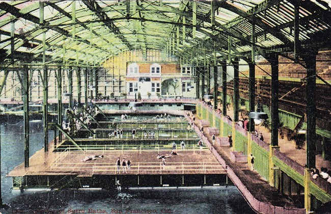 historic colored postcard showing interior of ornate public bathhouse