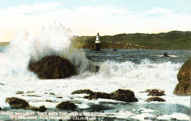 historic colored postcard of waves crashing over rocks with Lands End shore in background