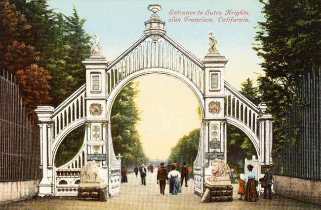 historic colored postcard of ornate garden gate with people entering