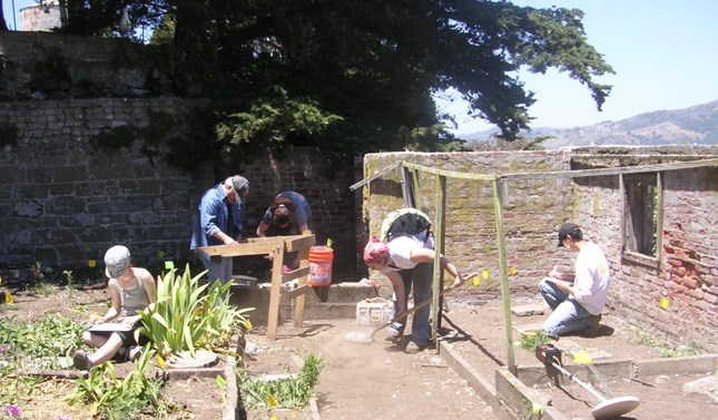 people working outside with tools