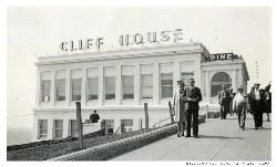Cliff House with a couple standing in front