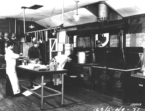 photo of Army cooks working in a World War II kitchen