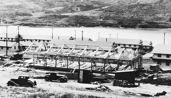 a wood frame barracks under construction
