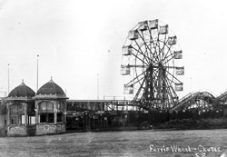 view of Ferris Wheel and wooden stands, with rail road tracks