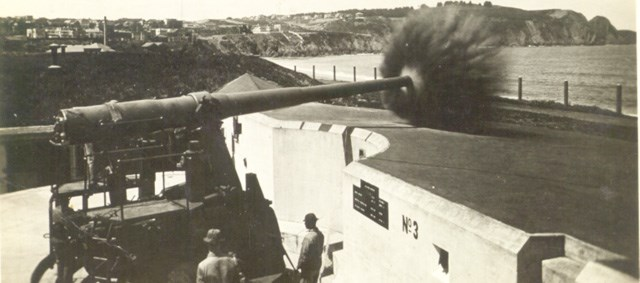 large concrete cannon firing near beach
