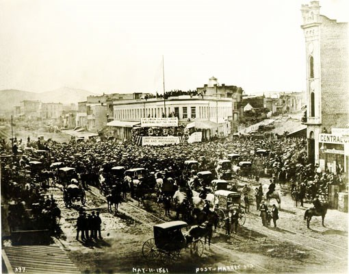 historic photo of Union demonstration with crowd of people and horse-drawn carriages