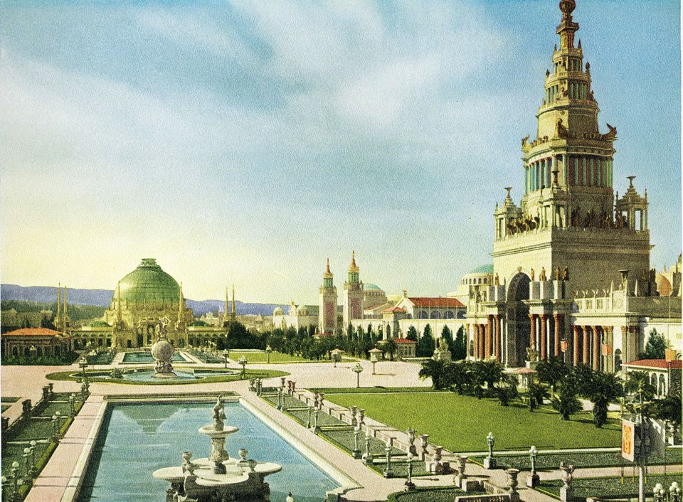 postcard image of tall ornate buildings near fountain