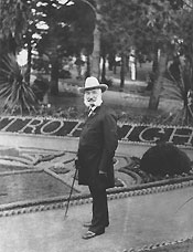 Photo of Adolf Sutro in front of formal gardens, circa 1885.