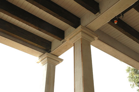newly constructed capitals at porch ceilings