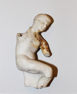 small sculpture piece of person