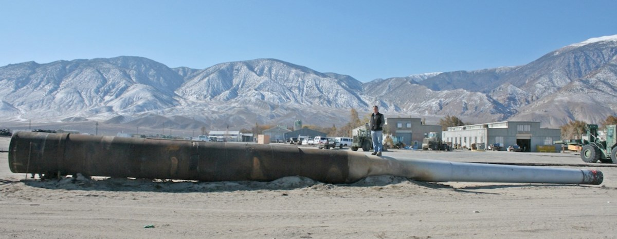 The 1 inch by 68 foot long gun laying in the desert