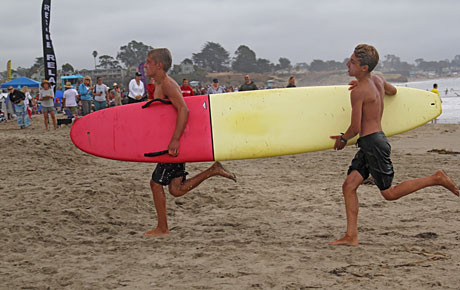 Junior lifeguards training on beach