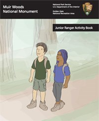 Cover of Jr. Ranger book with two young people on a trail in the redwods