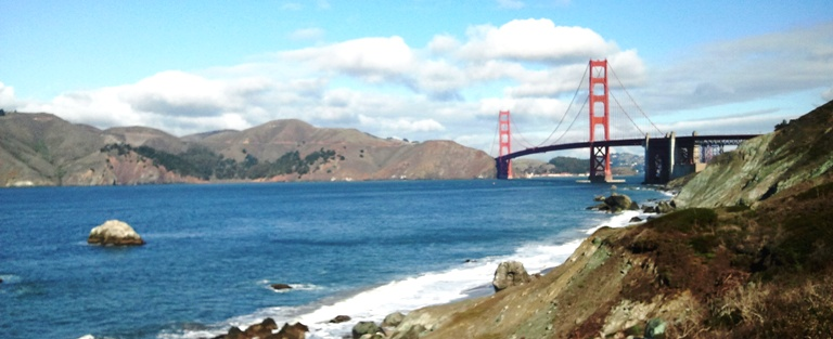 View of the Golden Gate Bridge from the Presidio Coastal Trail on the south side of the brdige on a warm, sunny day. Photo by Samantha Pollak.