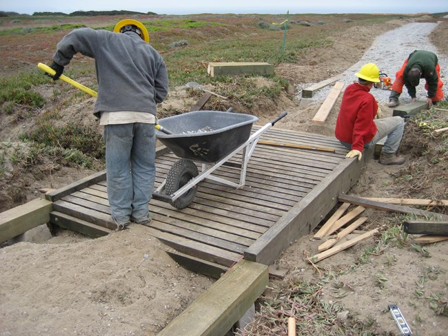 Student Conservation Corps members working on Sunset Loop Trail at Fort Funston.