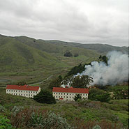 Smoke rising from a pile burn at Fort Barry in the Marin Headlands