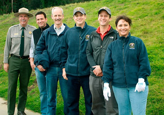 The following speakers welcomed the volunteers at Crissy Field (left to right): Interim Superintendent of Golden Gate National Parks, Frank Dean; Deputy Director for the Golden Gate National Parks Conservancy, Doug Overman; Presidio Trust Executive Director, Craig Middleton; Interior's Director of External Affairs, Ray Rivera; Vice President of Marketing for The North Face, Aaron Carpenter;  and Community Engagement Specialist for Toyota, Kathy Mota.