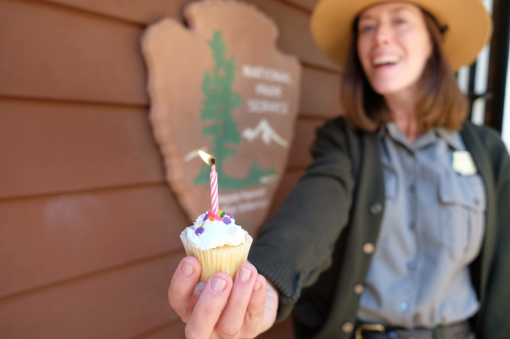 park ranger with cupcake and birthday candle