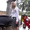 Daryl Hannah putting biofuel in her vehicle.