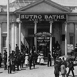 "black and white photo of crowd coming out of ""sutro baths and museum"""