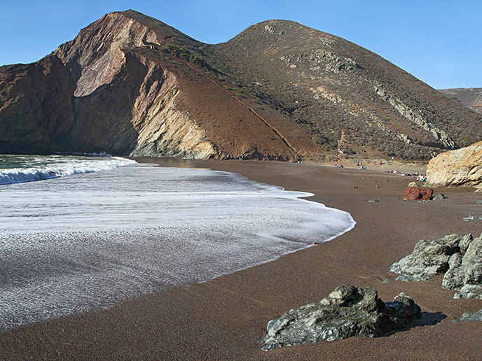 Tennessee Cove with beach in foreground and cliffs behind