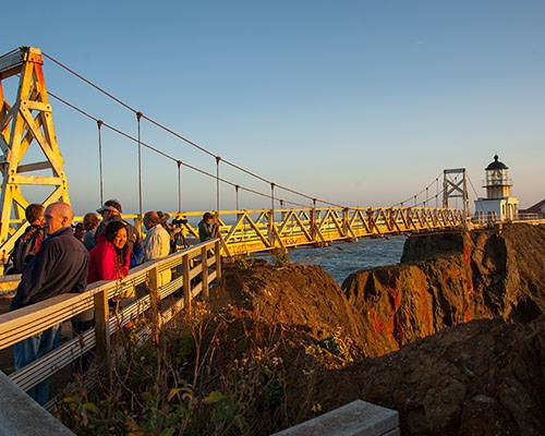 Point Bonita with visitors near the suspension bridge during sunset