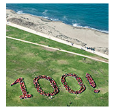 Aerial photo of people forming the number 100