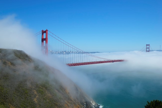 A view of the Golden Gate Bridge with fog from Battery Spencer.