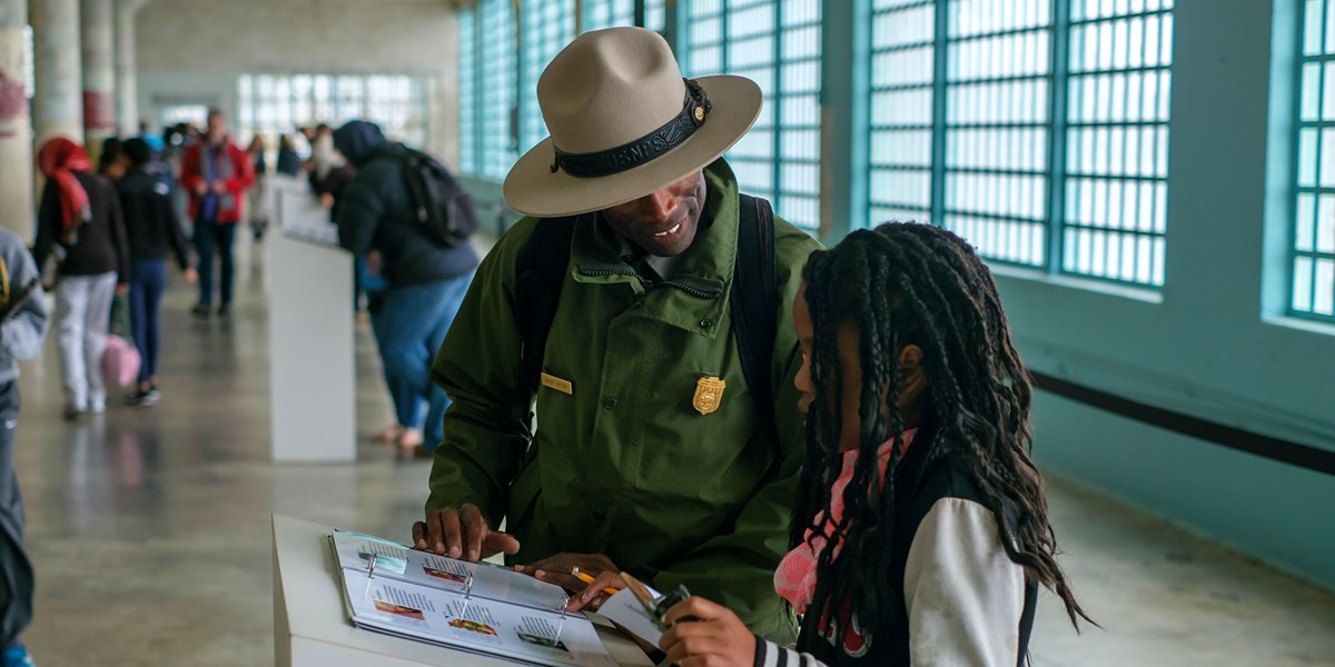 ranger benny talking to female student in alcatraz cellhouse