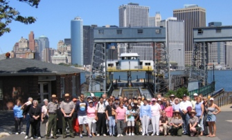 Park Rangers pose with visitors from the final tour of the 2005 Summer Season.