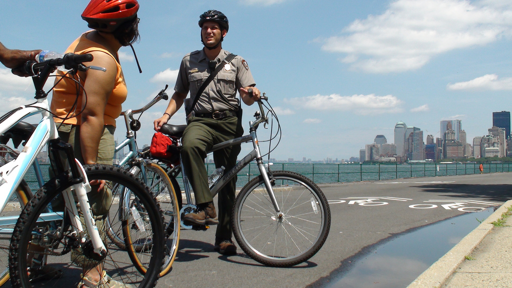 A Ranger provides a bike tour on the Island