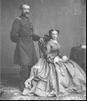 "George and Libby Custer Born in 1842, Elizabeth ""Libby"" Bacon married George Armstrong Custer in 1864. The Custers traveled to posts in Kansas and Dakota. After his death at the Battle of the Little Big Horn in 1876, she moved to New York City. She wrote three books about their life at frontier posts. The first book Boots and Saddles in 1885, followed by Tenting on the Plains in 1887 and Following the Guidon in 1890. She died in 1933 having her version of Custer's life accepted over other histories."