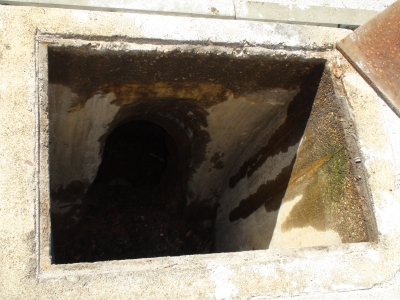The air-shaft entrance to the intact underground chamber.