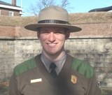 Ranger Brent standing in front of Fort Jay.