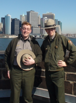 Rangers Adam and Greg on the roof of Castle Williams, with Manhattan's Financial District in the background.