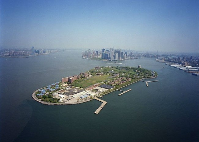 Aerial of Governors Island with Manhattan in the center background and Brooklyn on the right