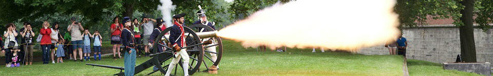Visitors watch a cannon firing demonstration