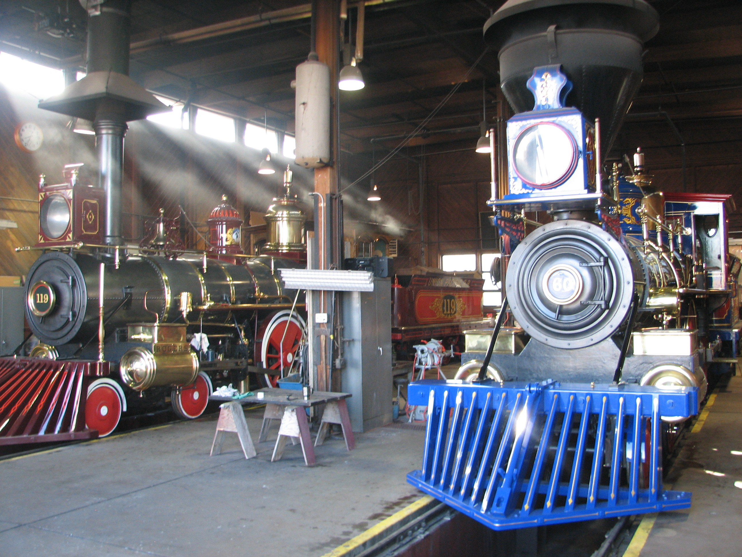 Locomotives No. 119 & Jupiter in the engine house.