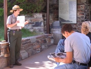 Seasonal ranger speaking to visitors