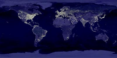 View of the earth from space at night, showing distribution of light pollution.