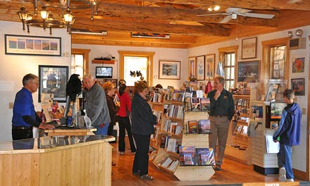 interior of north rim bookstore showing the checkout on the left and shelves with books on the right