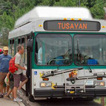 Several park visitors boarding the Tusayan shuttle bus.