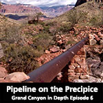 rusted pipeline supported by stone pillar recedes into Grand Canyon Landscape